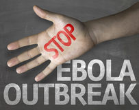 Educational and Creative composition with the message Stop Ebola Outbreak on the blackboard Royalty Free Stock Photos