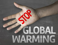 Educational and Creative composition with the message Stop Global Warming on the blackboard Royalty Free Stock Images