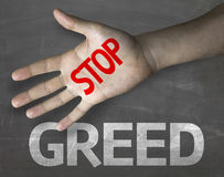 Educational and Creative composition with the message Stop Greed on the blackboard Stock Photo