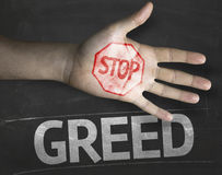 Educational and Creative composition with the message Stop Greed on the blackboard Royalty Free Stock Photo