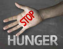 Educational and Creative composition with the message Stop Hunger on the blackboard Stock Images