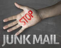 Educational and Creative composition with the message Stop Junk Mail on the blackboard Stock Images