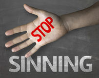 Educational and Creative composition with the message Stop Sinning on the blackboard Royalty Free Stock Photography