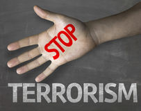Educational and Creative composition with the message Stop Terrorism on the blackboard.  Stock Photos