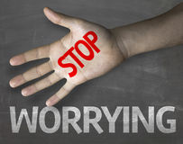 Educational and Creative composition with the message Stop Worrying on the blackboard.  Stock Photography