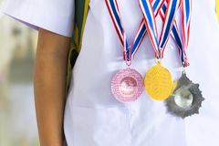 Educational examinations, silver medals, bronze medals. Education is important in laying the foundations of life, students receive medals from educational stock images