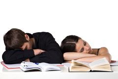 Educational exhaustion. Photo of two exhausted students, napping, isolated Stock Photo