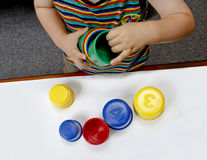 Educational games. Baby playing with plastic cups educational royalty free stock photo