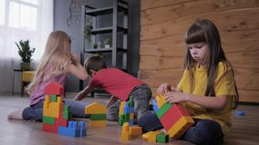 Educational games, friendly children have fun playing in colorful constructor and build unusual toys from details