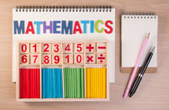 Educational kids math toy wooden board stick game counting set in kids math class kindergarten. Stock Photos