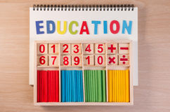 Educational kids math toy wooden board stick game counting set in kids math class kindergarten. Stock Photo