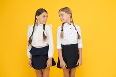 Educational program for gifted kids. Best pupils award. Making everything right. Excellent pupils. Girls perfect uniform. Outfit on yellow background. According stock photos