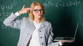 Educational reforms concept. Tired teacher annoyed by her job. Woman tired or annoyed holds laptop. Educator smart royalty free stock photo