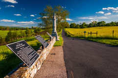 Educational signs and a statue along a road in Antietam National Stock Photos