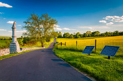 Educational signs and a statue along a road in Antietam National Royalty Free Stock Image