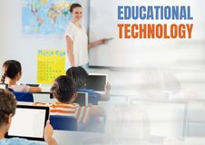Educational technology text and Elementary school teacher with class. Digital composite of Educational technology text and Elementary school teacher with class stock image