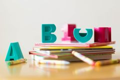 Educational tools and books for children. Letters on top of a stack of books. Education for younger kids Stock Photo