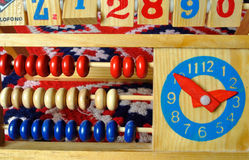 Educational Toy. Wooden educational toy comprising counting beads, numbers and clock stock photography