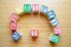 Educational toy cubes with letters organised to display word DESCRIPTION - editing metadata and Search engine. Optimisation concept stock images