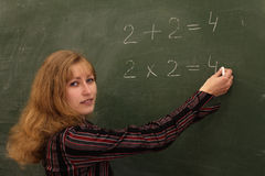 Educator. The teacher explains the multiplication table Royalty Free Stock Photography