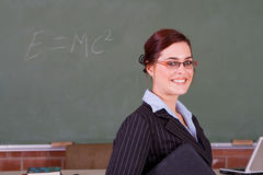 Educator. Beautiful smart school teacher educator in classroom Stock Photo