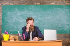 Educator bearded man yawning face tired at work. Educators more stressed at work than average people. Exhausting work in. School causes fatigue. Life of teacher stock photography