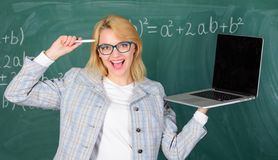 Educator cheerful lady with modern laptop surfing internet chalkboard background. Education is fun. Digital technologies. Concept. Woman teacher wear eyeglasses stock photos