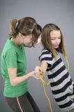 Educator explaining exercises. White woman teaching her student jumping rope movements Stock Photo