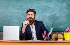 Educator finished explanation, asking is all clear. School teacher prepare ask questions. Teacher bearded hipster with stock image