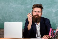 Educator finished explanation, asking is all clear. Who ready to answer question. School teacher prepare ask questions stock photo