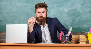 Educator finished explanation, asking is all clear. Who ready to answer question. Teacher bearded hipster with stock photography