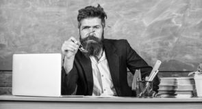 Educator finished explanation, asking is all clear. Who ready to answer question. Teacher bearded hipster with stock images