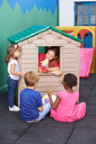 Educator playing theater in playhouse. Educator playing theater for children in a playhouse in preschool Stock Images