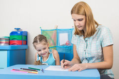 Educator shows the five-year child draw with pencils Royalty Free Stock Image