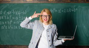 Educator smart clever lady with modern laptop hold gun gesture at her head chalkboard background. Tired teacher annoyed royalty free stock image