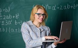 Educator smart clever lady with modern laptop searching information chalkboard background. Learn it easy way. Digital. Technologies concept. Woman teacher wear royalty free stock photos