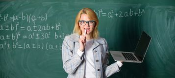 Educator smart clever lady with modern laptop surfing internet chalkboard background. Digital technologies concept. Idea royalty free stock photography