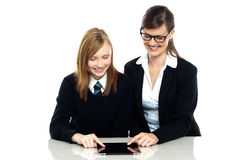 Educator and student exploring a tablet device Royalty Free Stock Image