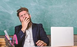 Educators more stressed at work than average people. High level fatigue. Educator bearded man yawning face tired at work stock photos