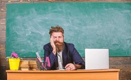 Educators more stressed work than average people. High level fatigue. Exhausting work in school causes fatigue. Educator. Bearded man sleepy face tired sit royalty free stock photos