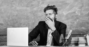 Educators more stressed at work than average people. High level fatigue. Exhausting work in school causes fatigue. Educator bearded man yawning face tired at royalty free stock photos