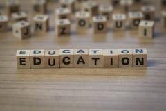 Edukacja pisać w drewnianych sześcianach Zdjęcie Royalty Free