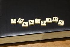 Edukashun on book Royalty Free Stock Photography