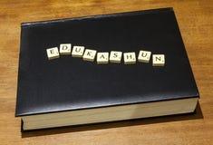 Edukashun on book Stock Photo