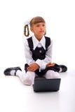 Eduque a menina com portátil foto de stock