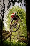 Downhill mountainbike rider. Eduro cup race in finland, mountain bikers racing down the tracks against the clock. Event was Ride More Cup, city Kouvola, Mielakka Stock Images