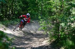 Downhill mountainbike rider. Eduro cup race in finland, mountain bikers racing down the tracks against the clock. Event was Ride More Cup, city Kouvola, Mielakka Royalty Free Stock Images