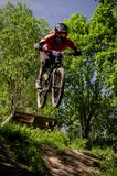 Downhill mountainbike rider. Eduro cup race in finland, mountain bikers racing down the tracks against the clock. Event was Ride More Cup, city Kouvola, Mielakka Stock Photography