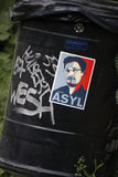 Edward Snowden. CIRCA MAY 2014 - BERLIN: an image of Edward Snowden on a sticker demanding granting him asylum in Germany on a garbarg can in the Tiergarten royalty free stock photography