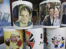 Edward Snowden and Other Coffee Mugs in China - Sn. An Edward Snowden coffee mug sitting with other coffee mugs at a shop in China Stock Images